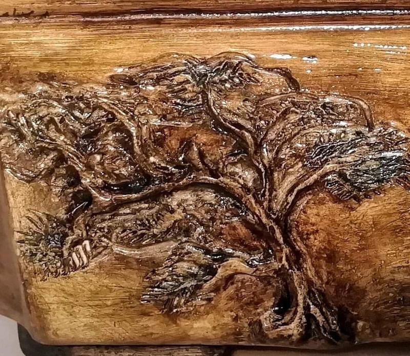 carved tree with glaze